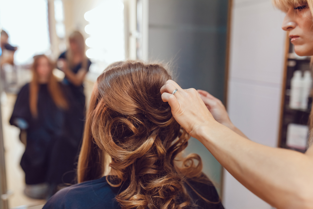 hair stylist doing a bridal look