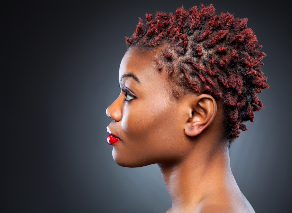 Side view or beautiful woman with tightly cut kinky hair