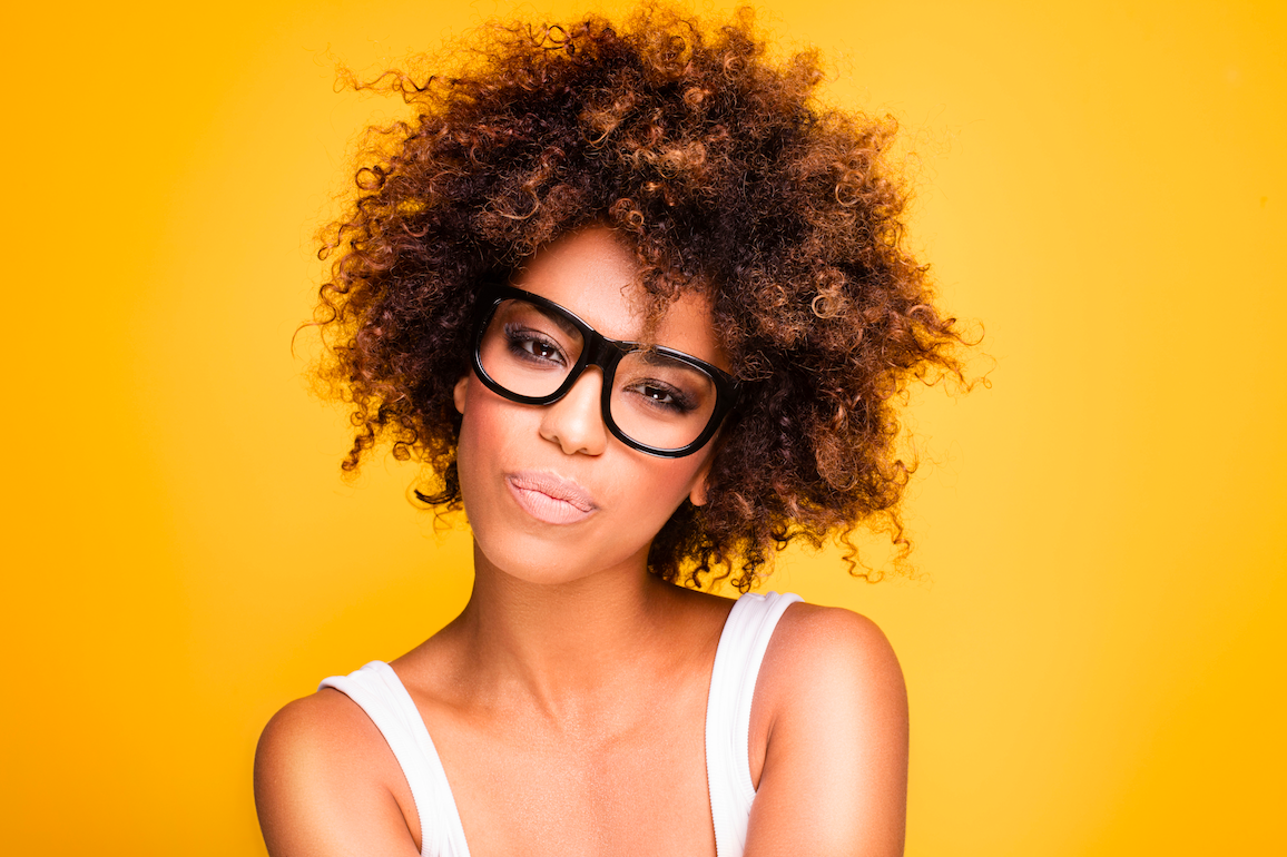 African American woman with glasses and crazy kinky hair