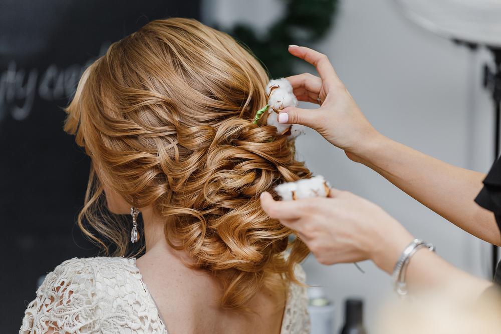 stylist doing bride's hair