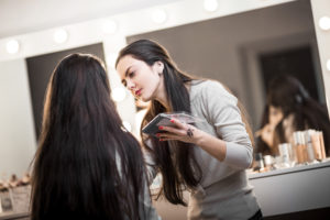 makeup artist doing makeup on a client
