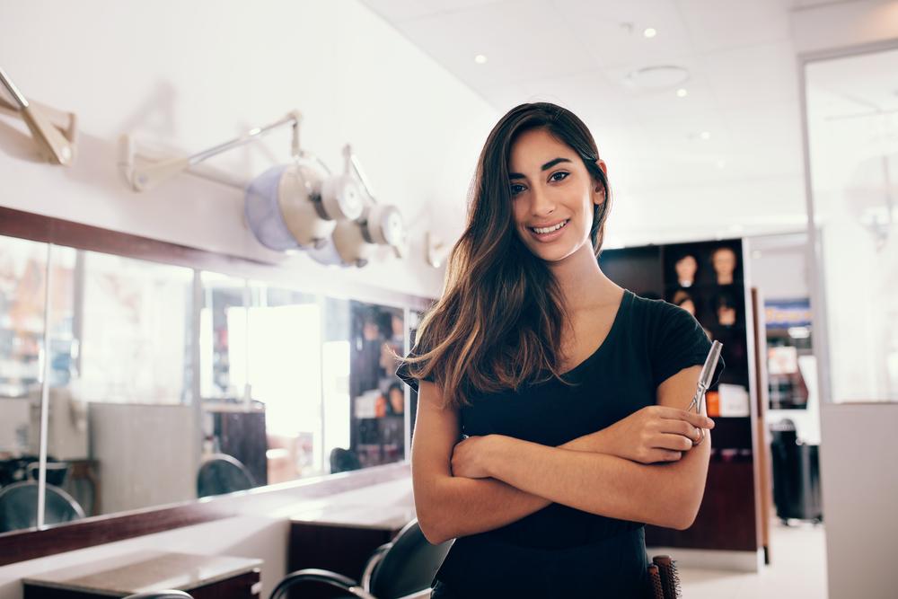 hair stylist crossing arms in salon