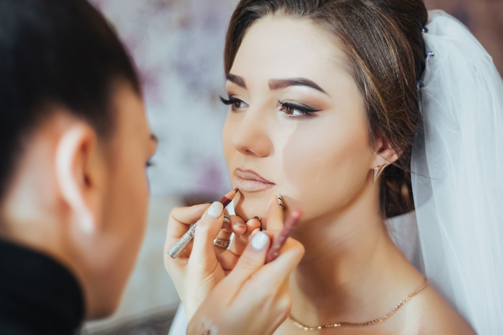 Applying makeup for a wedding.